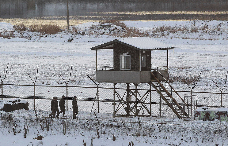 South Korean army soldiers patrol along the barbed-wire fence near the border with North Korea