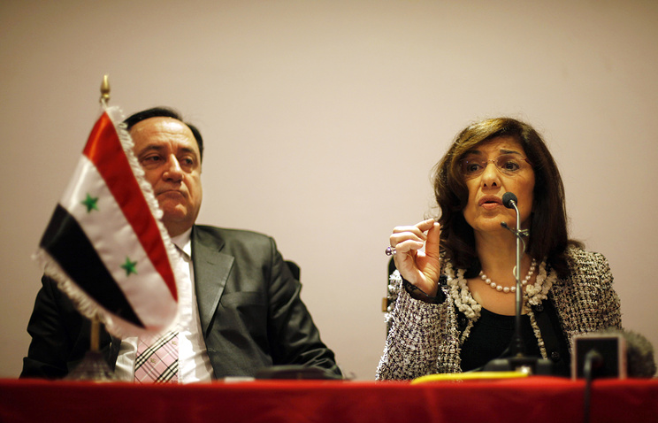 Buthaina Shaaban (R) at a press conference