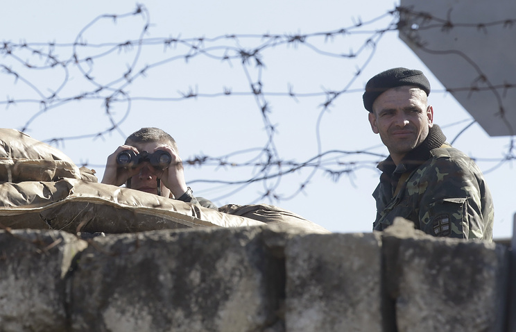 Ukrainian soldiers guard the territory of their military unit