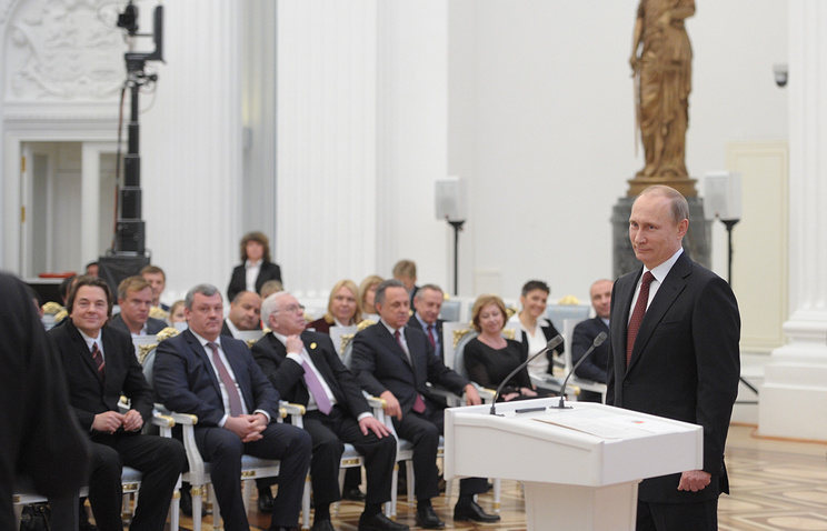Vladimir Putin speaks during a ceremony at the Kremlin where he presented state awards to organisers of the Olympic Games and heads of Russian sports federations