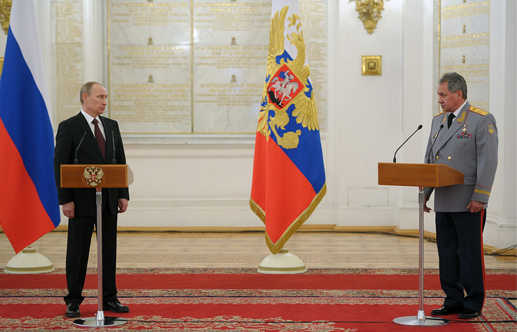 Vladimir Putin (left) and Russian Defense Minister Sergei Shoigu (right)