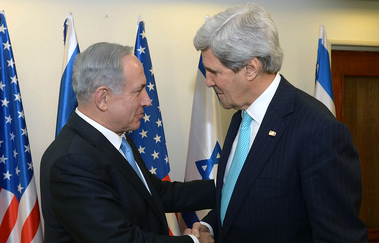 US Secretary of State John Kerry (R) as he greets Israeli Prime Minister Benjamin Netanyahu
