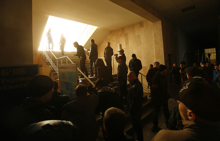 Protestors stand in the lobby of Ukrainian Security Service office in Donetsk