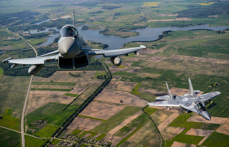 Typhoon FGR4 aircraft (L) and a MIG-29 Fighter jet seen during NATO Baltic Air Policing mission over Estonia, Latvia and Lithuania May 15