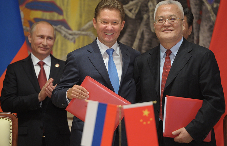 Russia's president Vladimir Putin, Gazprom management committee chairman Alexei Miller and China National Petroleum Corporation (CNPC) chairman Zhou Jiping