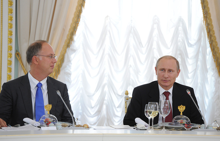 Kirill Dmitriyev (L), general director of the Russian Direct Investment Fund, and Russia's president Vladimir Putin at SPIEF 2014
