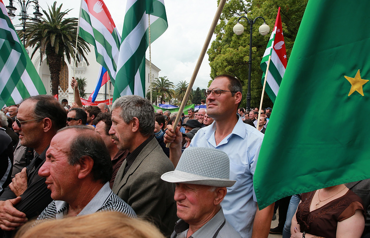 National flags of Abkhazia seen at a demonstration in Sukhum