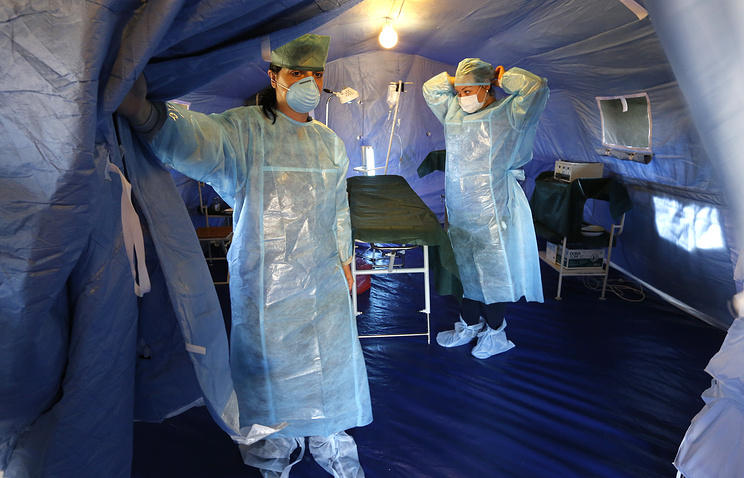 Doctors at a field hospital in a refugee camp in Russia