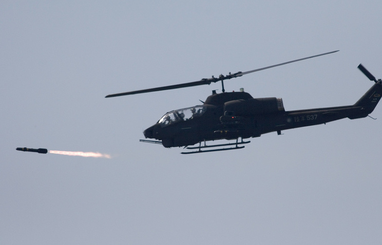 A helicopter fires a Hellfire air-to-surface missile (archive)