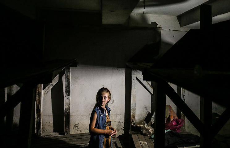 A girl in a bomb shelter, eastern Ukraine