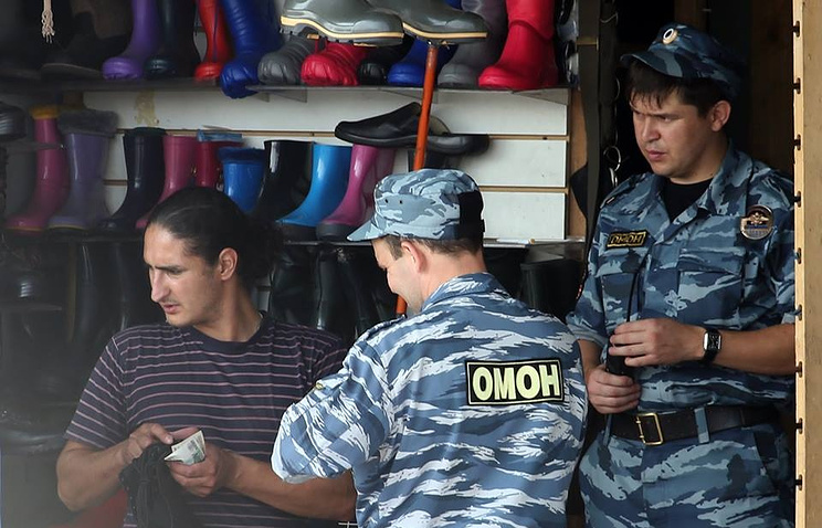 Police sweep of a street market in Russia