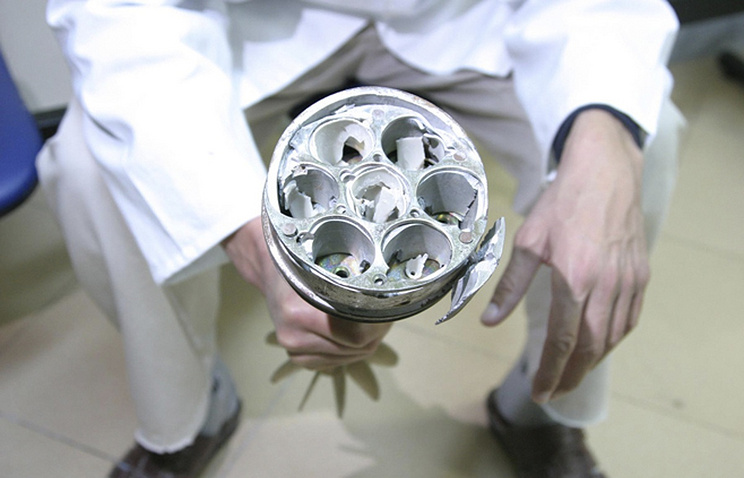 Remnant tail section of a cluster bomb (archive)