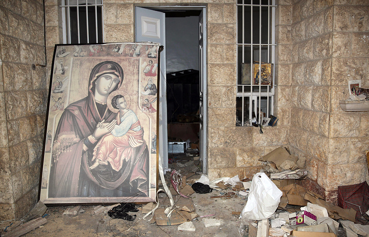 A damaged icon seen in war-torn Syria (archive)