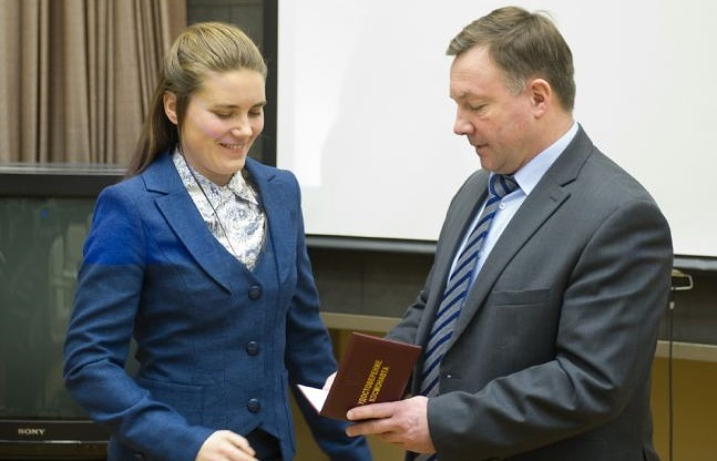 Anna Kikina and head of Cosmonaut Training Center Yury Lonchakov
