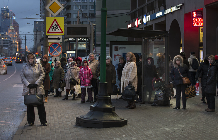 People at a bus stop in Moscow, Russia
