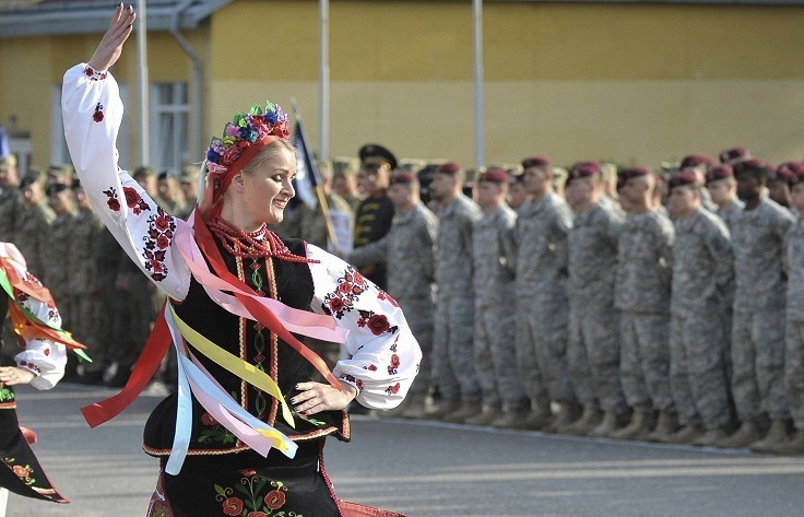 Ukrainian woman in national dress dances during the opening ceremony of the Rapid Trident military exercises in Ukraine