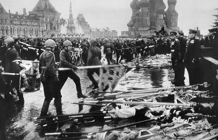 Soviet soldiers put down Nazi German flags in Red Square during the Victory Parade in 1945