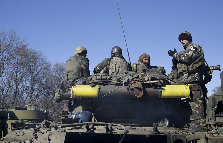 Ukrainian servicemen on an armored military vehicle