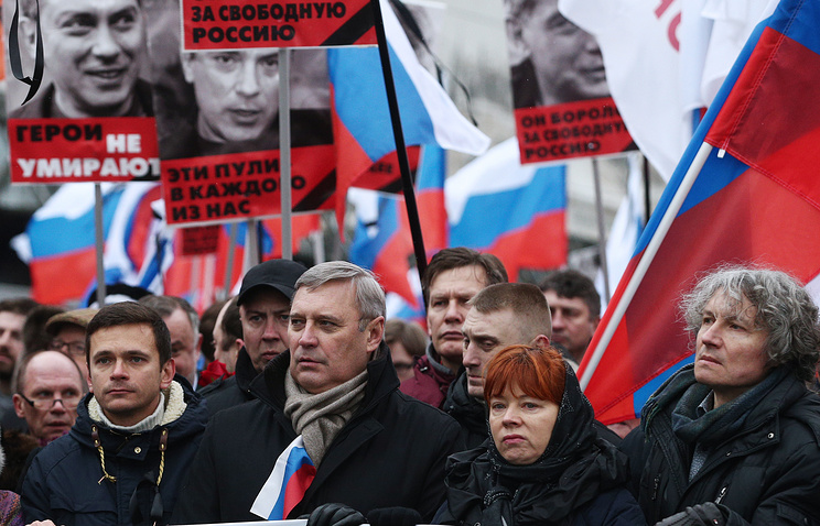 Russian opposition politicians and activists seen during a demonstration in memory of slain opposition leader Boris Nemtsov
