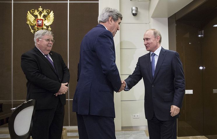 US Secretary of State John Kerry is welcomed by Russian President Vladimir Putin at the presidential residence of Bocharov Ruchey in Sochi