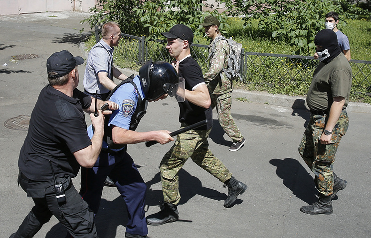 Radicals clashing with policemen during Equality March in Kiev