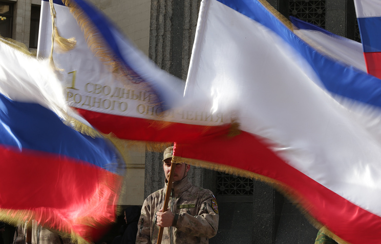 Crimean and Russian flags seen at a demonstration in March 2015