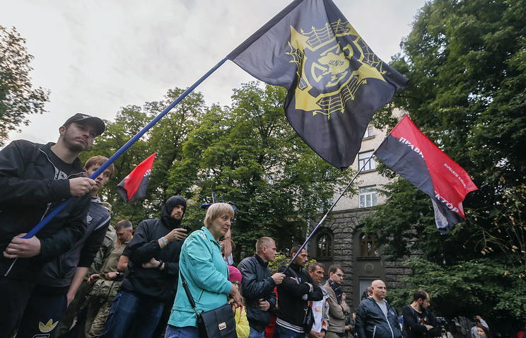 Supporters and members of Right Sector party and activists of other ultra-right movements attend their rally in front of Presidential office in Kiev, Ukraine, 11 July 2015