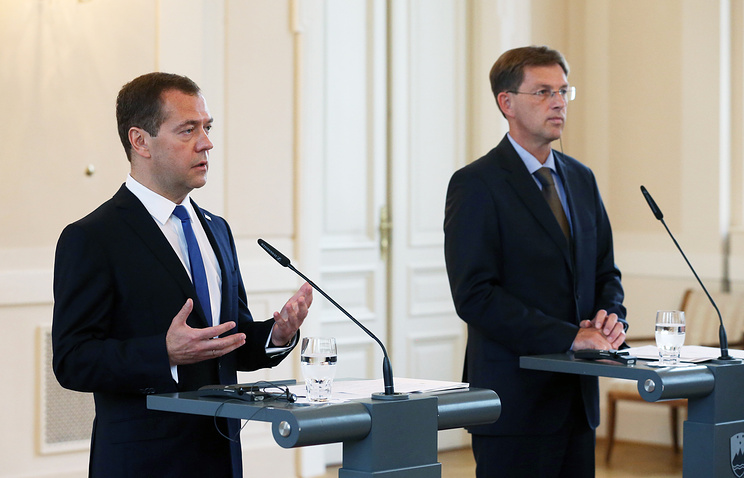 Russia's and Slovenia's Prime Ministers Dmitry Medvedev and Miro Cerar