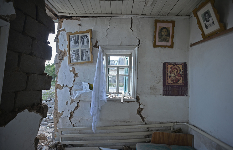 A destroyed house in Amvrosiyevka