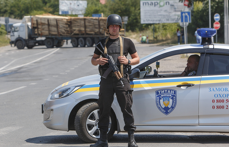Police officers secure the area near the western Ukrainian city of Mukachevo