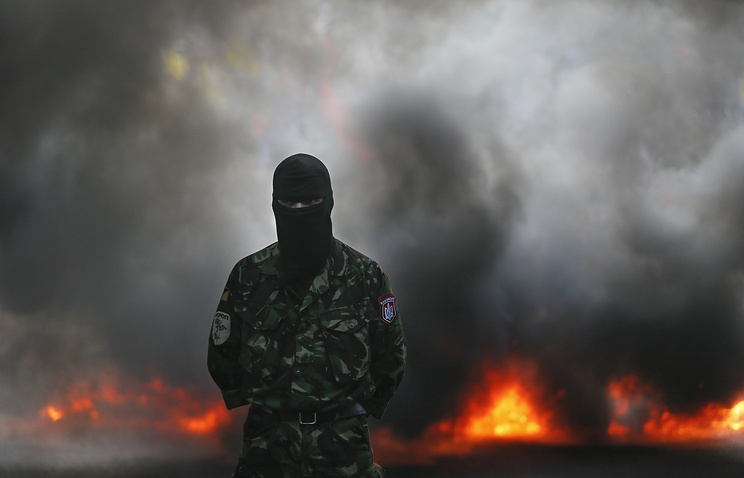 One of the members and supporters of Right Sector during their protest in Kiev, Ukraine