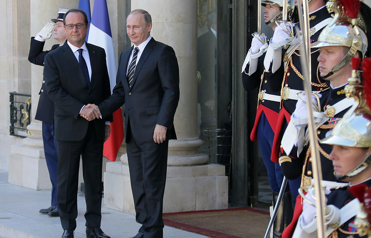 French President Francois Hollande and Russian President Vladimir Putin