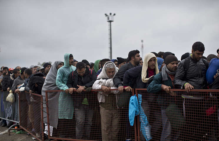 People waiting to get inside a reception center for migrants and refugees in Croatia