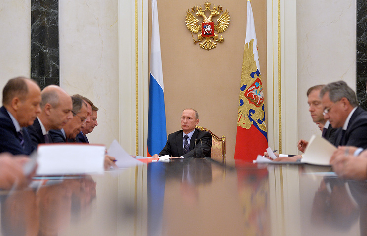 Russian President Vladimir Putin at a session of the commission for military and technical cooperation with foreign countries