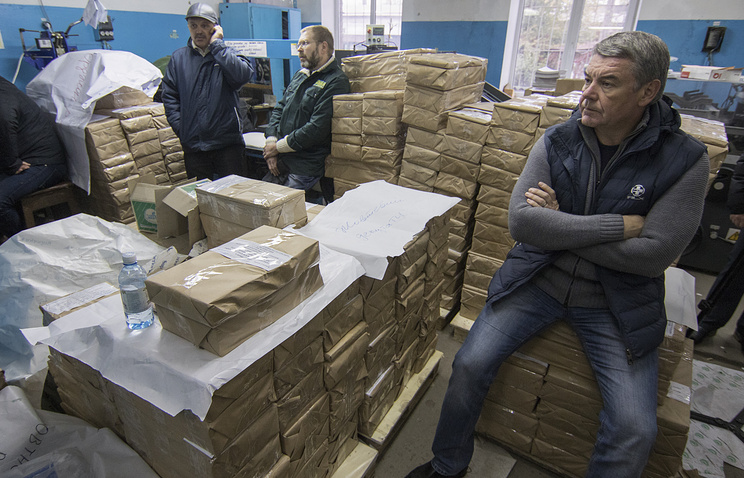 Members of local Ukraine election commission inspect ballot papers in a printing firm in the eastern city of Mariupol