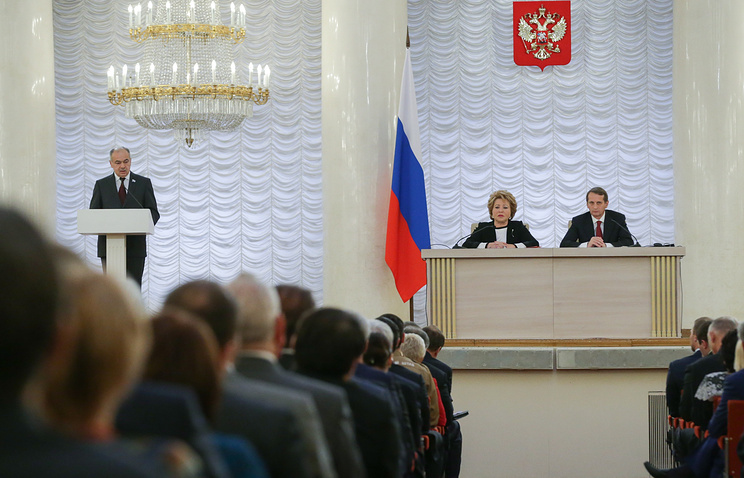 State Duma Speaker Sergey Naryshkin (right) at a joint meeting of both houses of Russia's parliament
