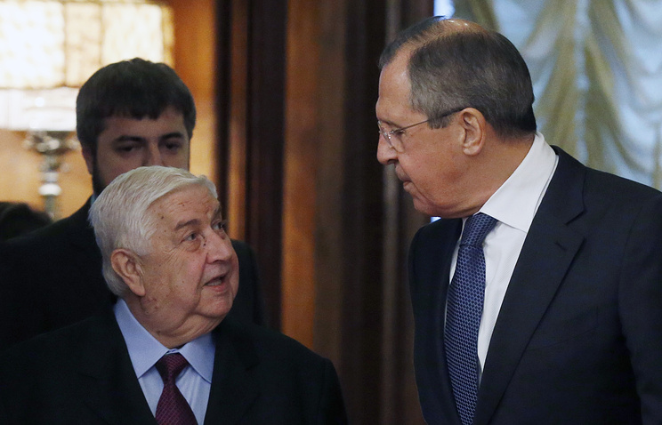 Syrian Foreign Minister Walid Muallem and Russian Foreign Minister Sergey Lavrov