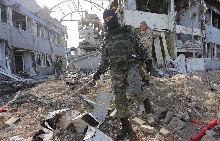 A soldier inspecting Donetsk Airport, Ukraine