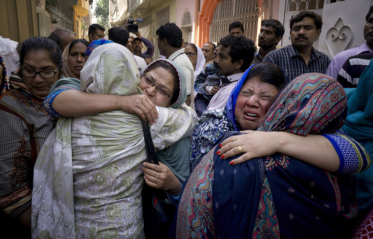 Family members of Pakistani boy killed by a massive suicide bombing in a public park in Lahore city