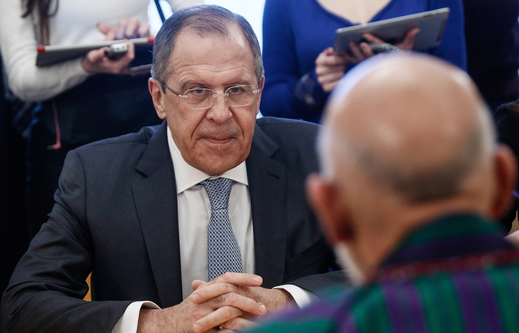Russian Foreign Minister Sergey Lavrov and former Afghan President Hamid Karzai