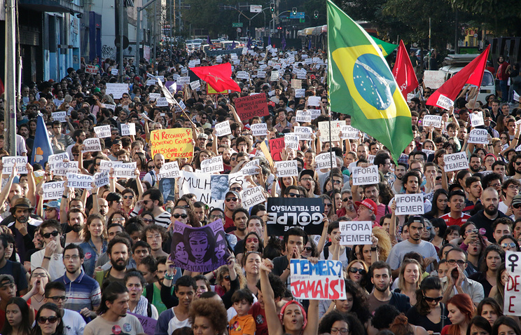 Thousands of demonstrators participating in a rally against interim President Michel Temer in Sao Paulo, Brazil