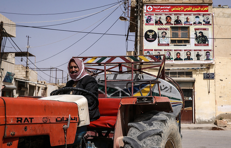 A local resident in a street. Homs Province, Syria