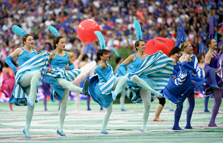 Dancers perform during the opening ceremony prior to the UEFA EURO 2016 group A preliminary round match between France and Romania at Stade de France