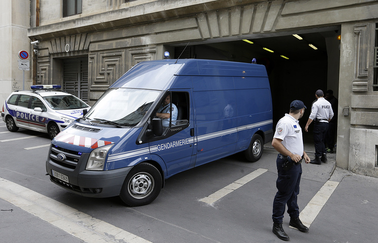 Police van exits from a court in Marseille where Russian football fans were sentenced to prison terms