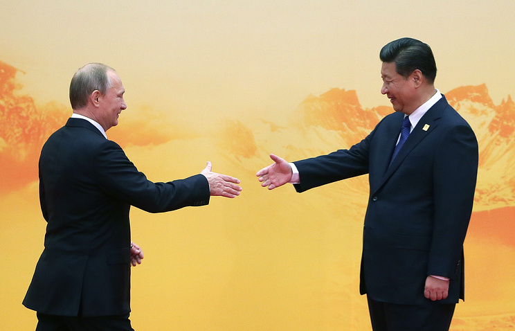 China's President Xi Jinping and Russian President Vladimir Putin, November 11, 2014