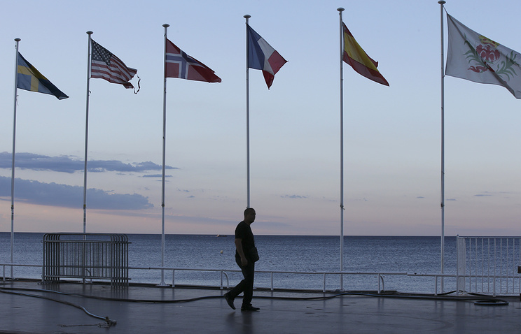 A security guard walks near the scene of the Nice attack