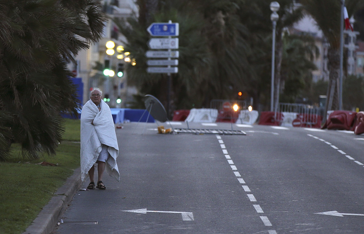A man walks near the scene of the attack in Nice, France