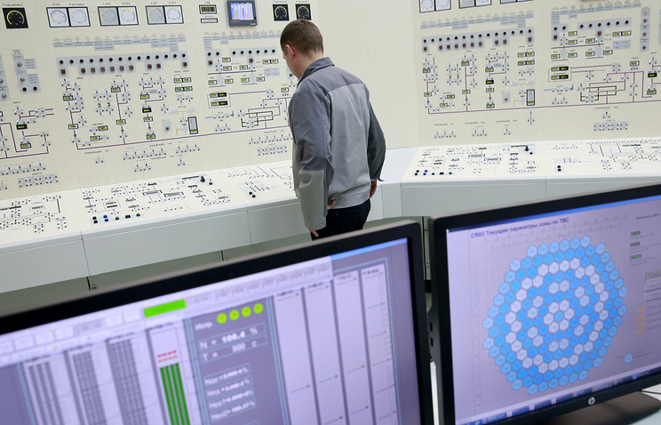 A worker of the Belarusian nuclear power plant practicing at the full-scale simulator of plant's power generating unit