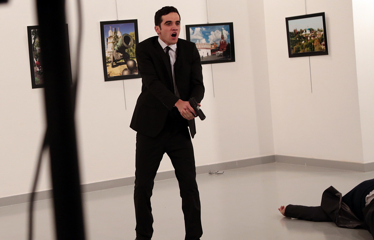 A gunman near to Andrei Karlov on ground, the Russian Ambassador to Turkey killed in Ankara