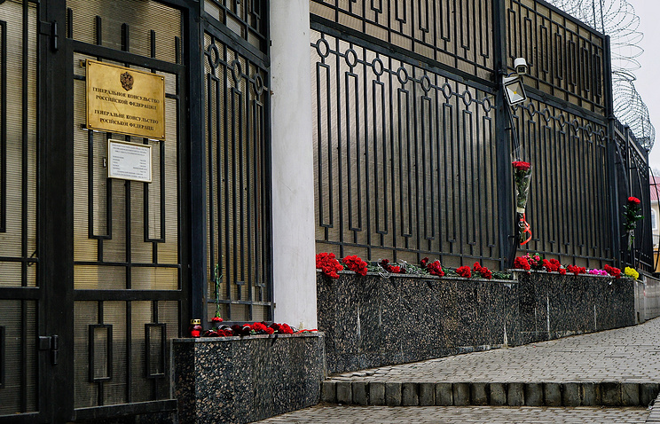 Flowers in memory of the victims of a Russian Tu-154 plane crash outside the Russian Consulate General in Odessa